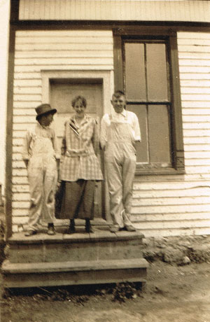 Graduates Alfred Lofquist, left, and Bennie Leighfield, right, share a light-hearted moment with teacher Gleah Brown on clean-up day, May 23, 1917. Photo is from the Bennie Leighfield collection, courtesy of Doris Evans Alexander.
