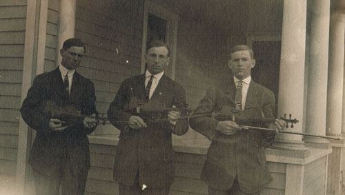 Pauline-area brothers Elmer, Harvey and Erle Jones are shown with their violins in this undated photo. Elmer was a featured violinist at Pauline's first high school commencement, held in May of 1915. Harvey was the future husband of graduate Rosanna Lofquist. Photo is from the Sarah Goding Post collection, courtesy of Kathy Post Seeman.