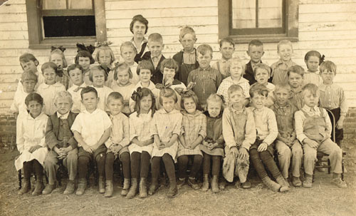 Pauline School's primary room students are pictured with teacher Mary Murray in 1916. Sarah Goding is in the front row, sixth from the left. Photo is from the Sarah Goding Post collection, courtesy of Kathy Post Seeman. An enlarged version of this photo appears at the end of this post, with identities of the remaining students given.