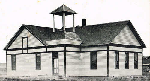 Pauline School's wood frame building, as it looked when Sarah Goding Post attended, 1916-1920. The photo is courtesy of Mrs. Post's daughter, Kathryn Post Seeman.