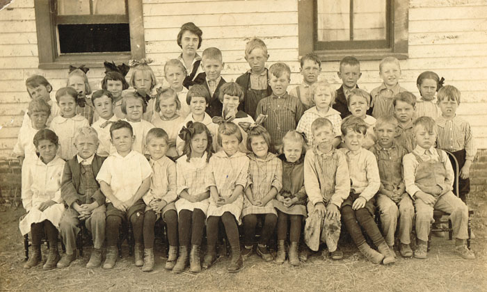 Pauline School's 1916 primary room students are pictured. From left are, front row: Velma Woods, Neil McDonald, McCleery Glazier, Bill Thos. McCleery, Myrtle May, Sarah Goding (Post), Katherine Goding (Heeren), Florence May, Charles Durward Quig, Fleming Meriwether, Silas Davis and Mark Sherman. Middle row: Janie May Davis, Wilhelmina Hibbeler, Darrel Bauder, Florence Throne, Pauline Reiber (Brown), Elsie Woods, Helen Smith, Walter Reiber, unidentified, Lee Snell, Ivan Hargelroad, Terrel Meriwether. Back row: Virginia Meriwether, unidentified, Irma Smith, Clara Evans, unidentified, Jack McCleery, Henry Evans, Corwin Hargelroad, Maxwell McCleery, unidentified, Sophia Hibbeler.
