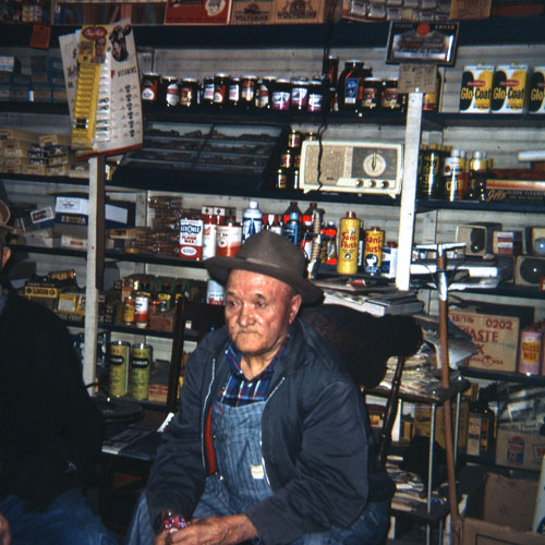 Frank Pavelka sits among the store wares.