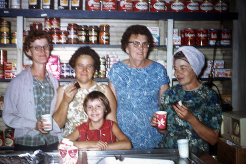 Pictured in back from left are Twilda Brown, Trionne Brown, Lizzie Evans and Eleanor Poen. Karen Post is the child in front. This was likely taken when store ownership changed hands for the last time in the late 1960s.