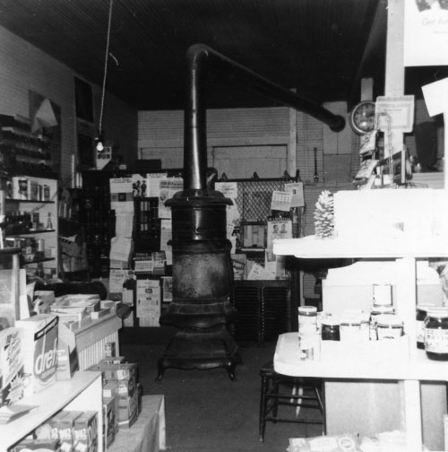 An interior view of the store. The post office is located behind the stove.