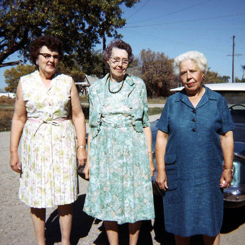 Lizzie Evans, Ella Herrenstein and an unidentified woman pose outside the store.