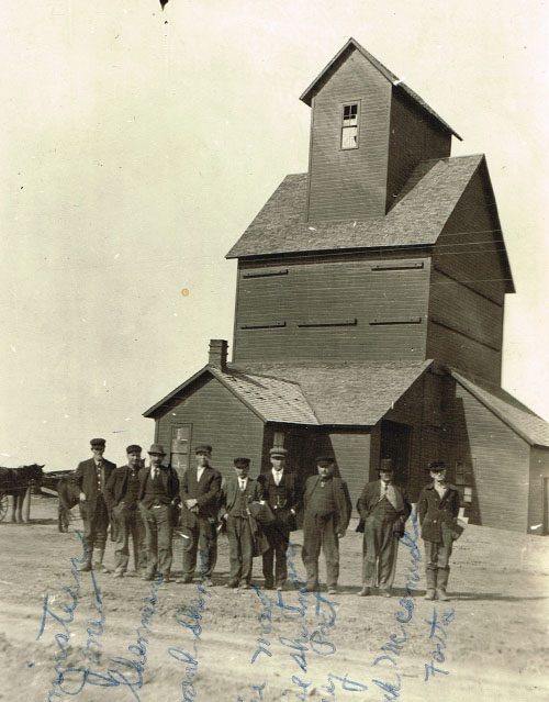The board of directors at Pauline's east elevator are shown in 1912. Pictured are R.J. Harrenstein, T.W. Jones, Ben Sherman, Frank Sherman, Ernie May, James Sherman, web editor's great-grandfather Barney Post, Frank McCormick and Joe Fouts. Photo is courtesy of Kathy Post Seeman.