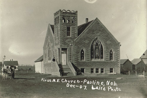 "The newly completed ""First Methodist Episcopal Church"" in Pauline, 1907. The partially obscured frame structure seen to the left of the building is likely the old frame church. Photo is from the Bennie Leighfield collection, courtesy of the late Doris Evans Alexander."