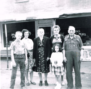 Lizzie and Owen Evans are pictured in front of their store in Pauline during the 1960s. From left are grandson Kim Swanson; unidentified woman; Mrs. Fate; Lizzie and Owen. Child is unidentified. Courtesy of Marlyce Brown.