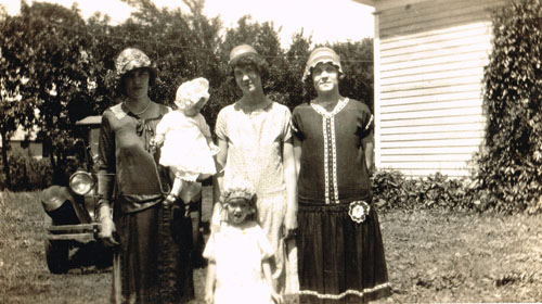 Lizzie is pictured here with her sisters and two young daughters. From left are Sarah Anderson holding Doris Evans; Mattie Anderson and Lizzie; Ruth Evans is standing in front of Mattie. Photo is courtesy of Marlyce Brown.