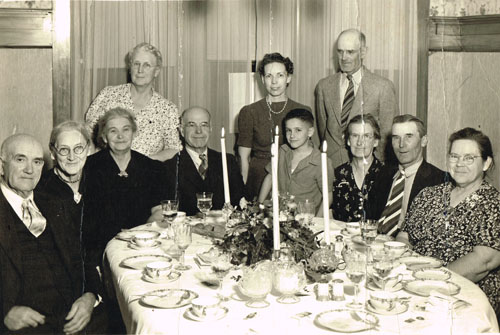 Two sibling pairs from the top photo are pictured in later life in this 1938 photo taken at the David Jones home in Hastings. David Jones is seated fourth from the left, with wife May standing behind. Frank and Ann Bourne are seated at the right. Photo is from the Sarah Goding Post collection, courtesy of Kathy Post Seeman.