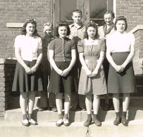 The Junior Class. Left to right, back row: Gene Juranek, Donald Hagemeyer and Mrs. Elizabeth Lindbergh, principal. Front row: Doris Evans, Wilma Pavelka, Betty Ann Moore and Mildred Rose.