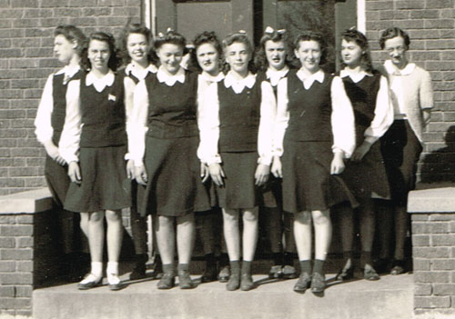 Pauline High School pep club members are, left to right, back row: Mildred Rose, Ila Beth Earl, Wilma Pavelka, Doris Evans, Betty Ann Moore and Mrs. Elizabeth Lindbergh, principal. Front row: Margaret Earl, Bonnie Moss, Jeanie Kluver and LaVonne Schmidt.