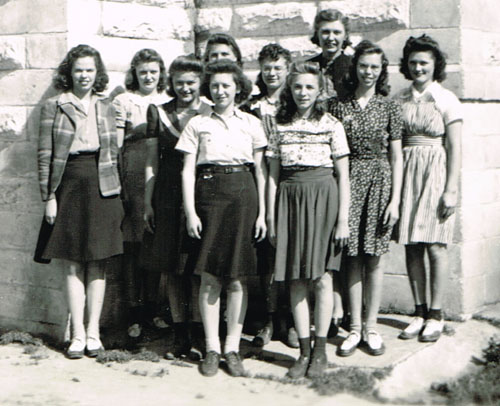 Members of the girls chorus were, left to right, front row: LaVonne Schmidt, Norma Jean Kluver. Second row, Bonnie Moss, Betty Moore and Margaret Earl. Back row, Ila Beth Earl, Doris Evans, Mildred Rose, director Mrs. Cora Lofquist, and Wilma Pavelka.