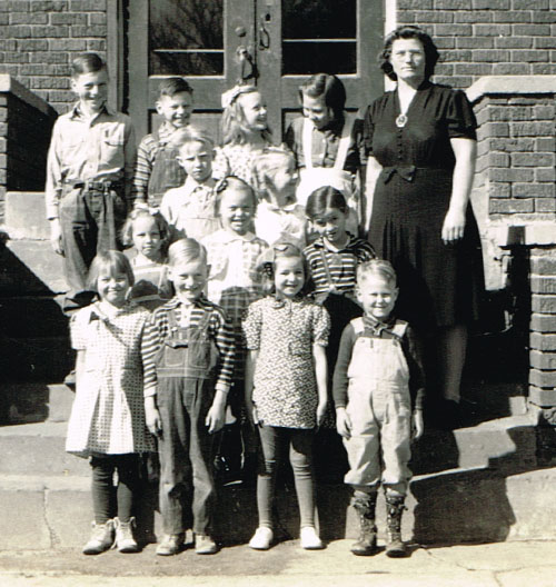 Pauline School primary room students are, from left, back row: Lamoine Brown, Ronald Cain, Gladys Bohlen, Delores Haughtaling, Miss Lois Krueger. Second row: Glenn Bohlen, Mary Ella Reiber. Third row: Bonnie Jean Smidt, Patsy Moore, Gale Cliffton. Front row: Virginia Haughtaling, Merle Dean Brown, Dorothy Kosmacek, Gary Reiber.