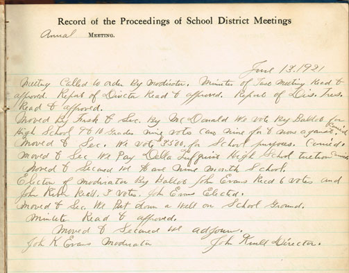 A page dating to 1921 from the school district director's record, showing steps taken toward the establishment of a two-year high school.